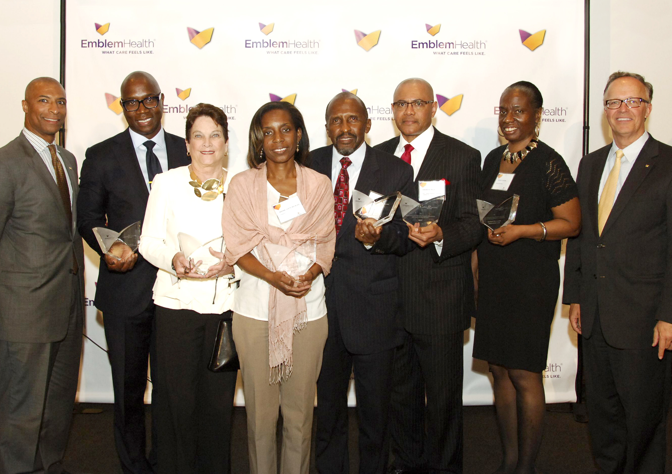 Photo 3 (Left to Right) David Flemister, Director of Community Marketing, EmblemHealth; Charles A. Archer, Esq, Chief Executive Officer, Evelyn Douglin Center for Serving People in Need; Joanne Oplustil, President and Chief Executive Officer, CAMBA; Nadine Juste-Beckles, Board Member, Dispora Community Services; Harvey Lawrence, President and Chief Executive Officer, Brownsville Multi-Service Family Health Center; Dr. Andre K. Peck, Executive Director, Haitian-American Community Coalition; Tracey Capers, Executive Vice President for Programs, Bedford Stuyvesant Restoration Corporation; Dave Mahder, Vice President of Marketing and Communications, EmblemHealth