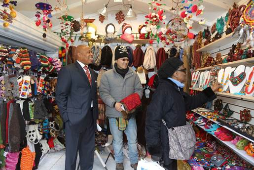 Brooklyn Borough President Eric L. Adams admires an assortment of wares being sold at the inaugural Holiday Market Village in Columbus Park.   Photo: Kathryn Kirk/Brooklyn BP's Office