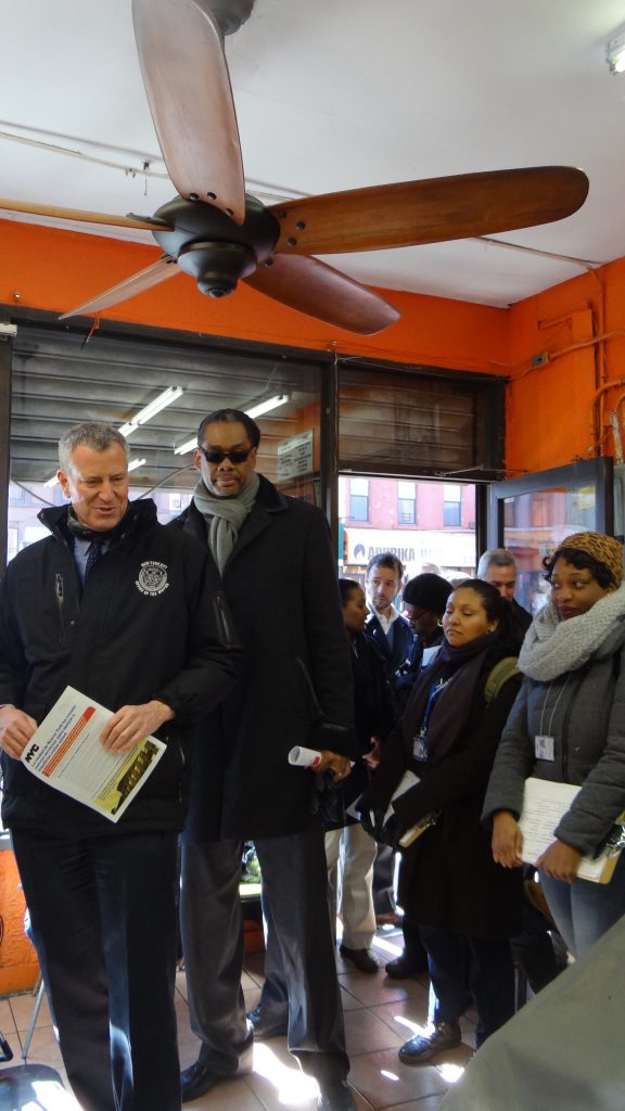 Mayor Bill de Blasio with City Councilmember Robert Cornegy at PJ's Hair Salon in Bed-Stuy