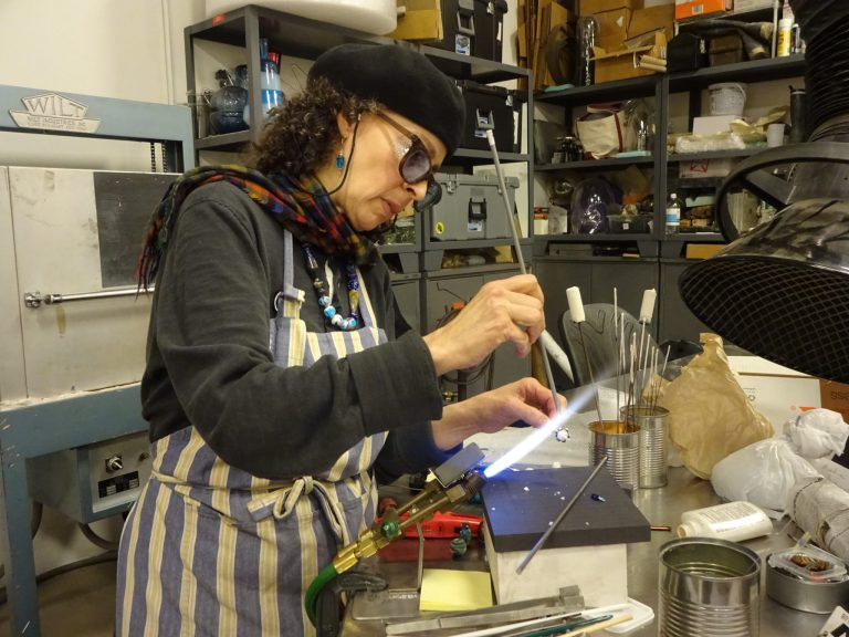 Maria Aroche, a Bead Project alum and teaching assistant, can craft a bead in mere minutes.