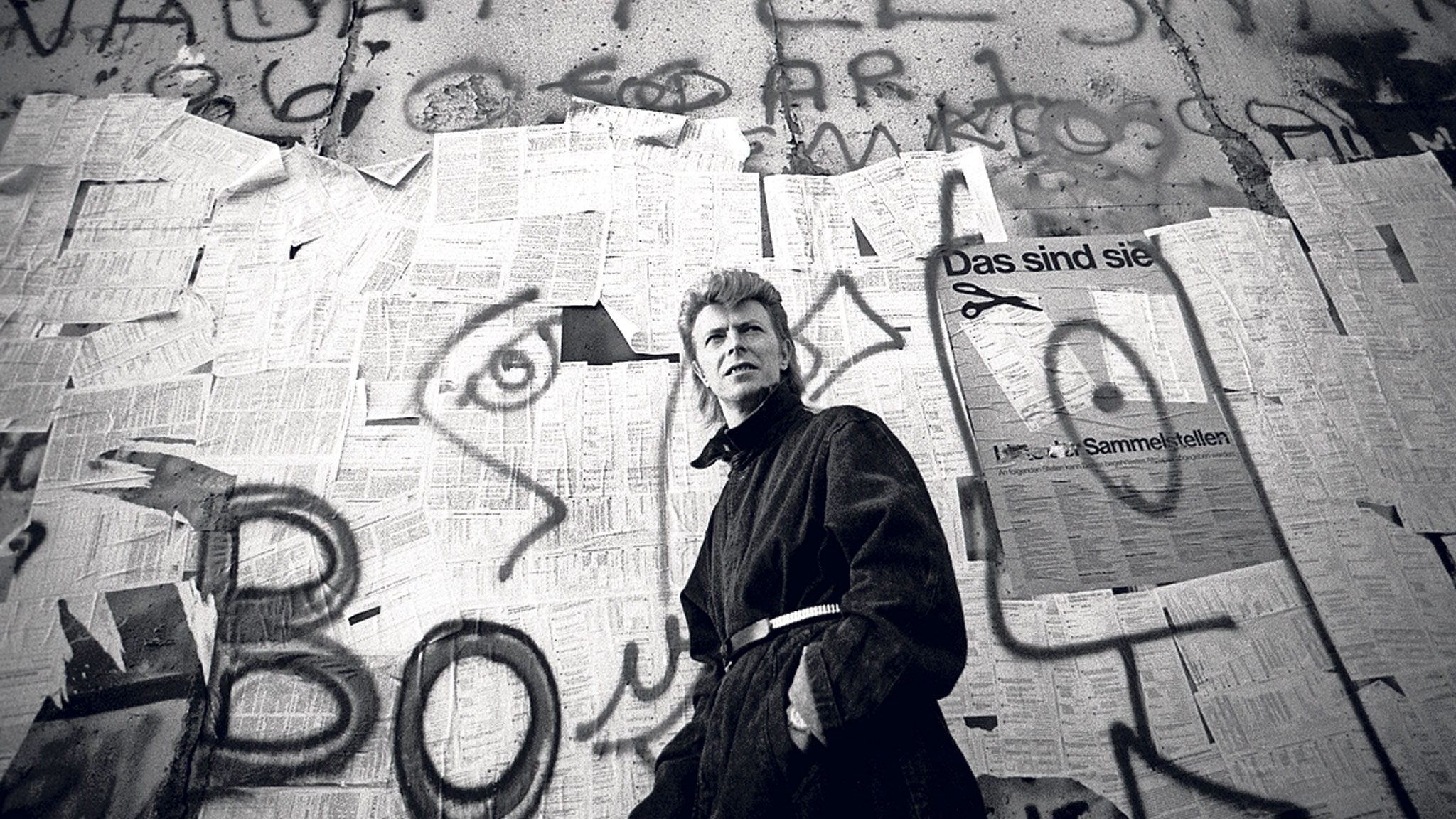David Bowie in front of the Berlin Wall.