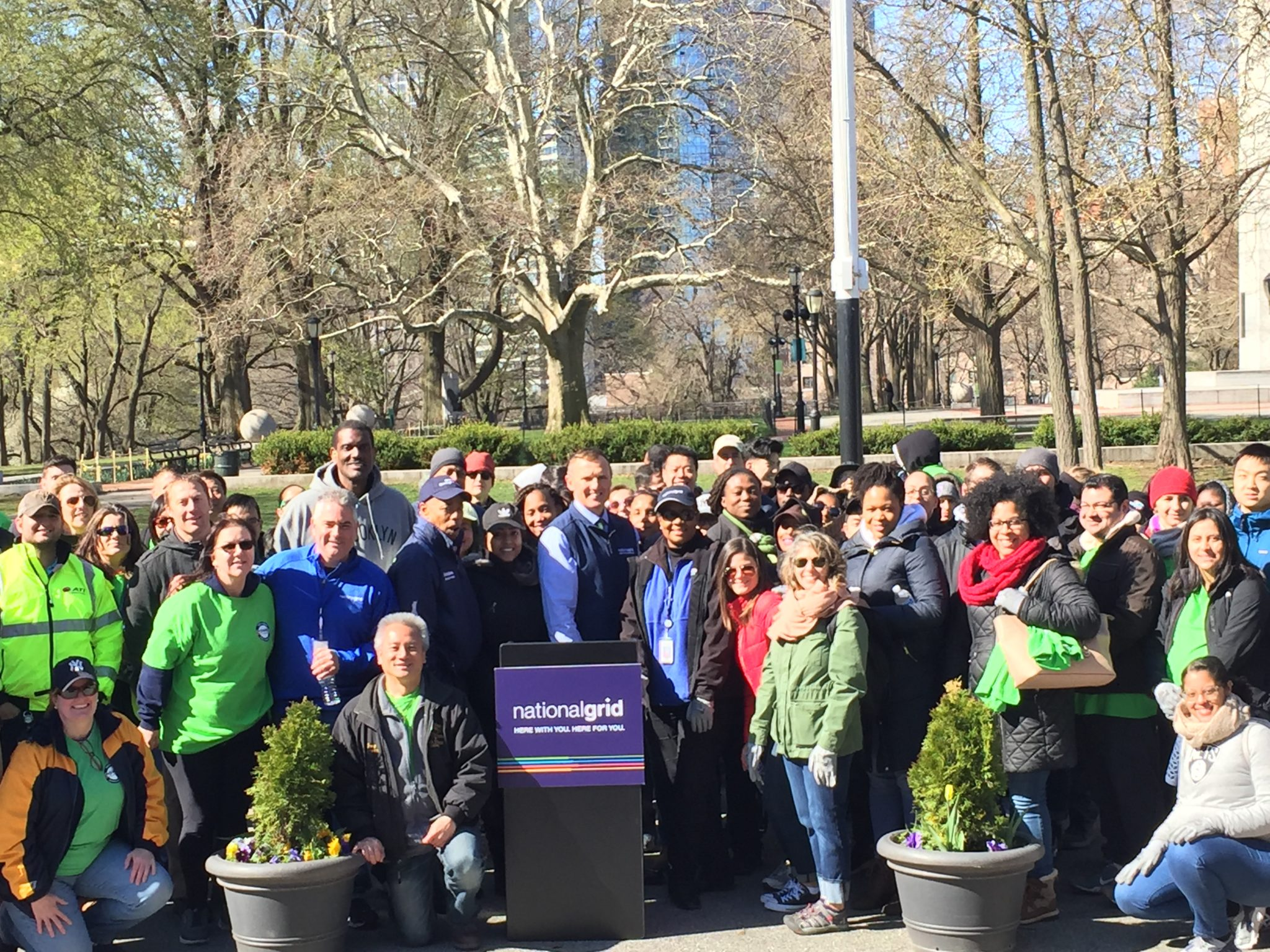 Group shot with volunteers and Ken Daly, COO, National Grid US Electric; Brooklyn Borough President Eric L. Adams; Brooklyn Nets Legend Albert King.