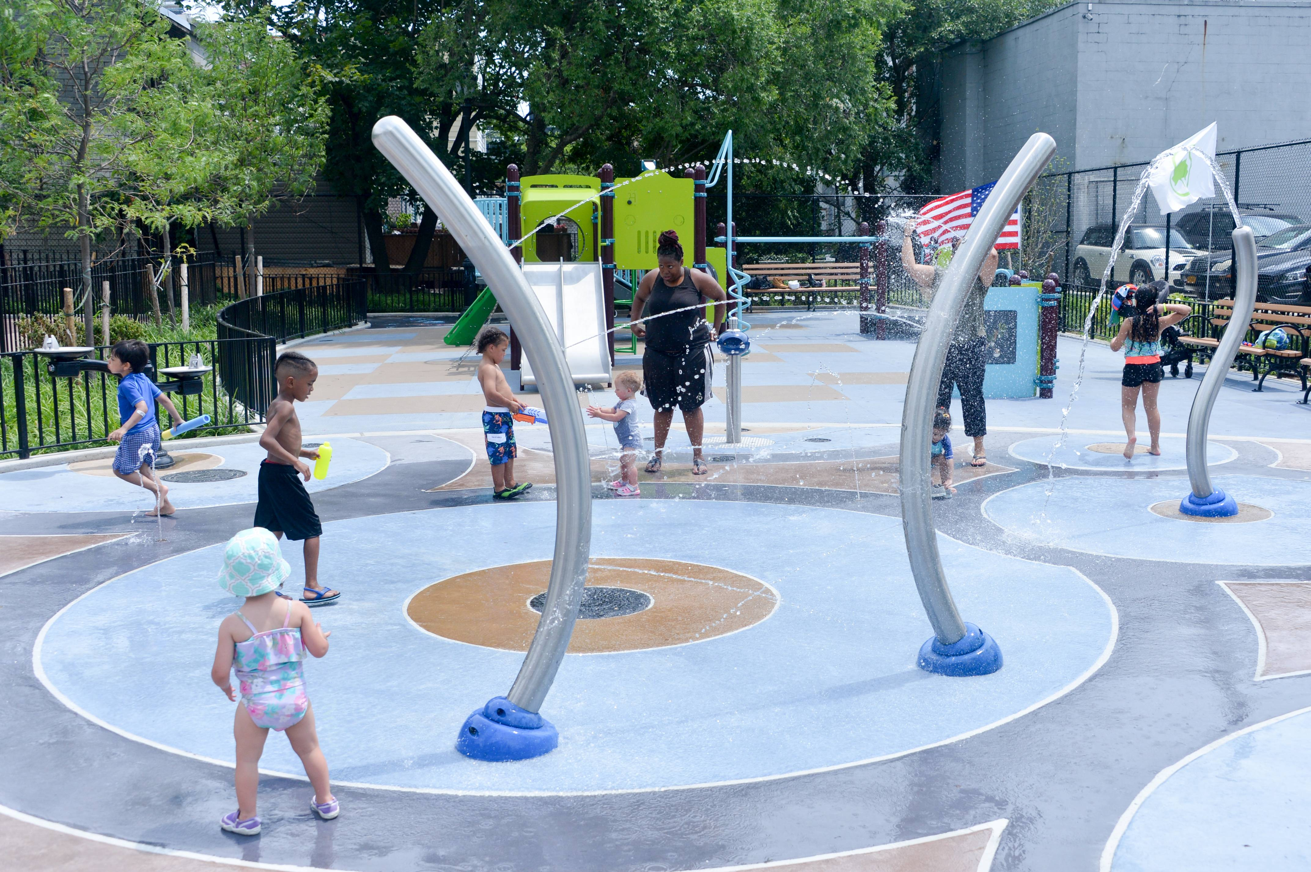 Spray showers and sprinklers in local parks are a great option to keep your kids cool if you can't make it to the pool or beach