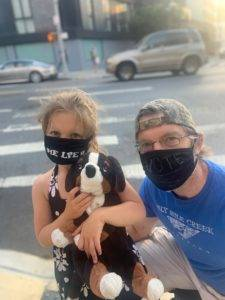 Frank Boudreaux and his daughter Fiona Boudreaux wearing masks on a walk in their neighborhood.